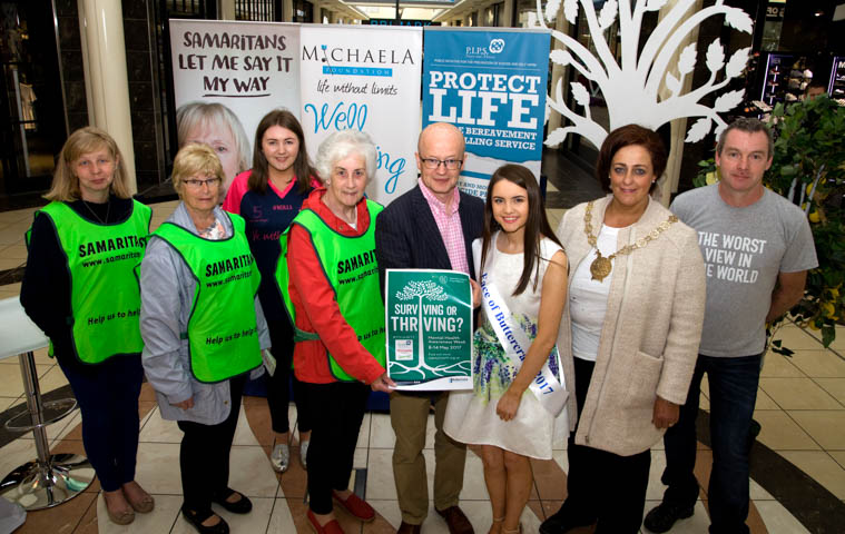 Pictured at an event in Buttercrane Shopping Centre highlighting Mental Health Awareness week were from left: Amanda Harris, Samaritans, Maria McGivern, Samaritans Amy Duffy, Michaela Foundation, Rosemary Doyle, Samaritans, Buttercrane Centre Manager Peter Murray, Face of Buttercrane Shauna McEvoy, Chair of NMDDC Gillian Fitzpatrick and Eamon Murphy PIPS.