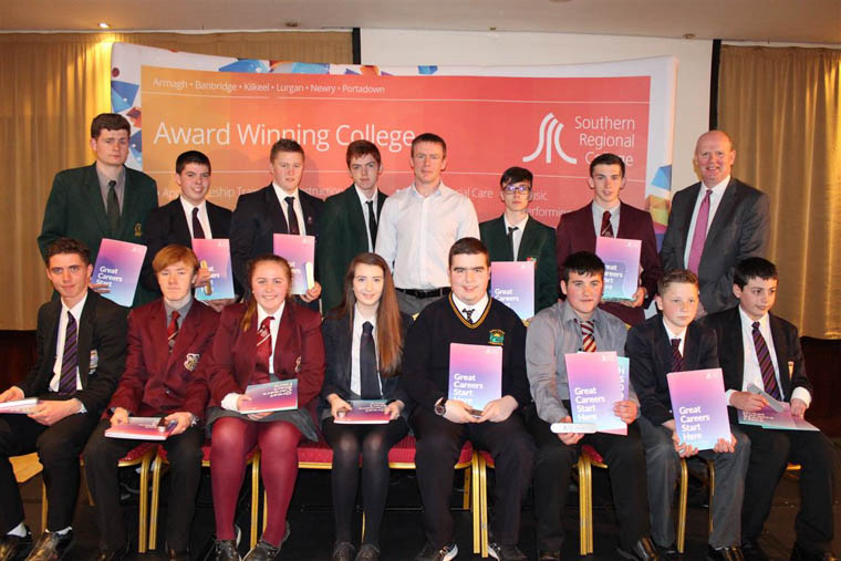 Justin McNulty Newry and Armagh MLA and Brian Doran SRC Chief Executive along with Top subject award winners from Newry Area